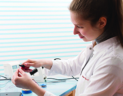 Photo of a BME/BSN dual degree student in the lab
