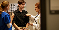 Photo of an MSN FNP student assessing a standardized patient