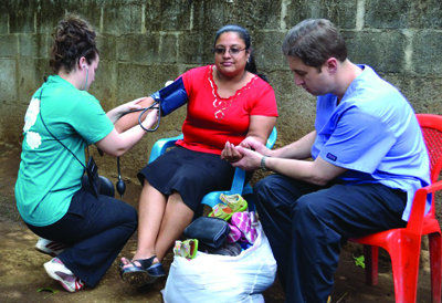 Photo of Students assessing a patient in Nicaragua