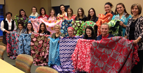 Photo of NCF members and the blankets they made fot The Children's Home