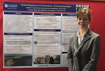 Photo of Dr. Melanie Turk with her poster