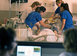 Photo of Nursing students during a simulation exercise in the lab