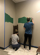 Photo of students painting mural