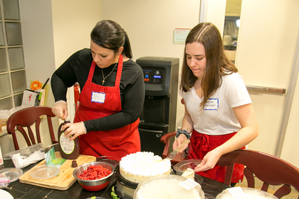 Photo of student volunteers preparing meals at Our Clubhouse's Valentine Dinner