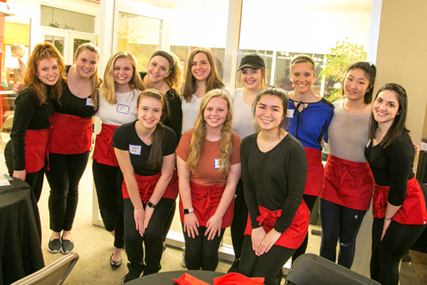 Photo of group of student volunteers at Our Clubhouse's Valentine Dinner