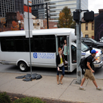 Students exiting Shuttle on Forbes