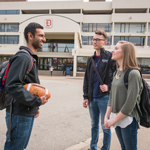 three students talking outside of the Union