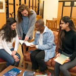 Four students studying at Gumberg Library