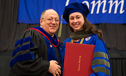 Maiah Deibert, pictured at the Duquesne University Mylan School of Pharmacy Class of 2016 Commencement Ceremony with Dean Bricker, received the Outstanding Student Award from the Pennsylvania Pharmacists Association in May 2016.