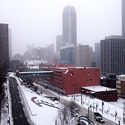 Snow falling on downtown Pittsburgh as seen from the Duquesne University campus.