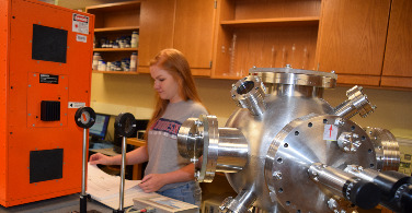 Physics Student working in optics lab.