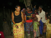 Joan Marshall dancing with friends in Togo
