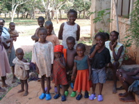 African children wearing CROCS from Brother's Brother Foundation