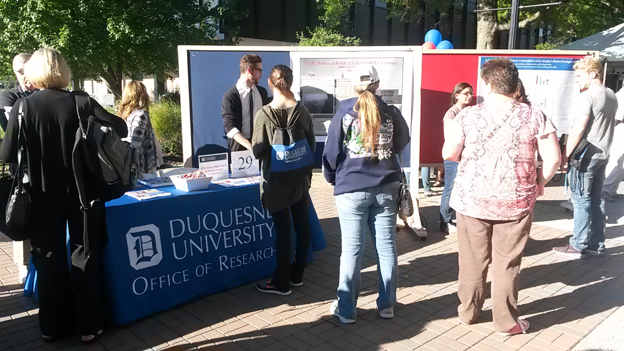 Office of Research booth on campus during Open House