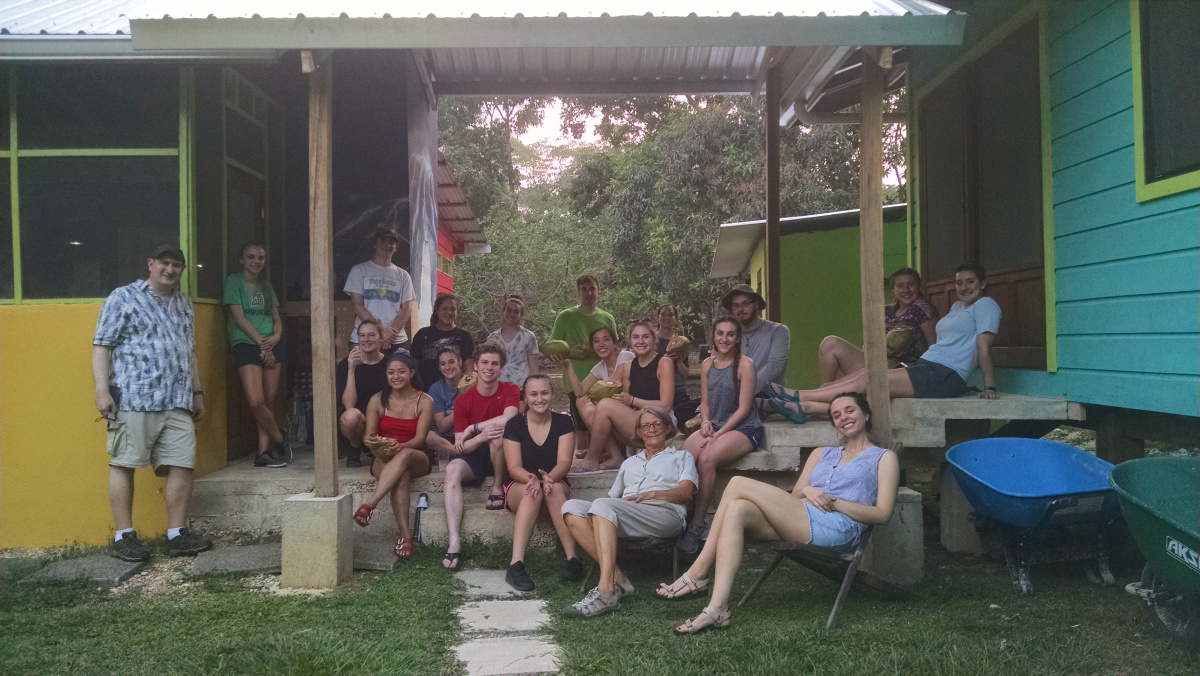 students pose for a photo while relaxing in Belize