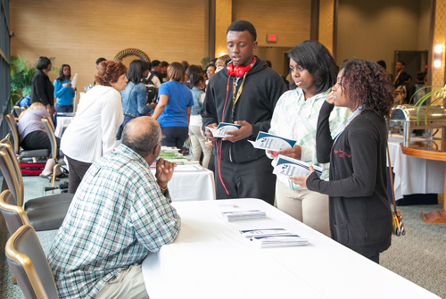 Mr. Reginald Bridges, Duquesne University, Learning Skills Center, networks with conference attendees and provides information on The Summer Institute.  The Summer Institute provides opportunities for high school students to stay on campus during the summer and earn credits towards their college degree.