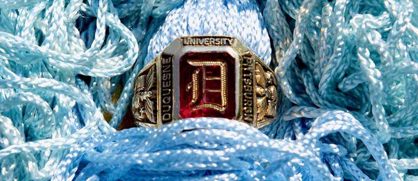 Red ring on top of School of Ed light blue tassel