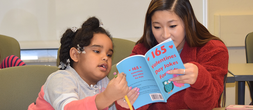 Duquesne student and reading clinic client reading book together