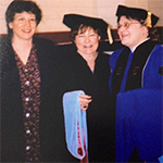 Dr. Peg Pankowski in center at graduation with attendees