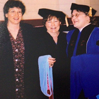 Dr. Peg in middle with colleaguues on each side on graduation day 2003
