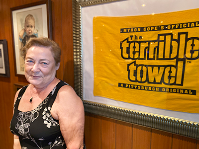 Dr. Peg with framed Pittsburgh Terrible Towel