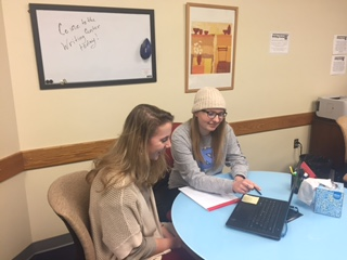 Image of a Writing Center consultant working with a client